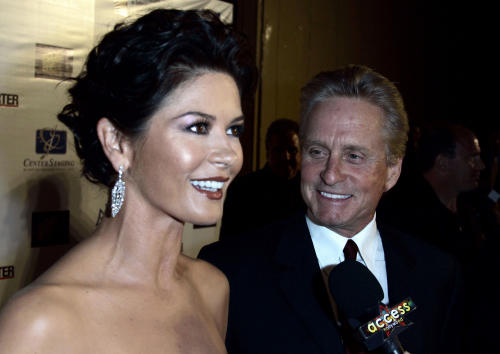 "FILE - In a Oct. 20, 2007 file photo, actors Catherine Zeta-Jones,left, and Michael Douglas are interviewed by members of the media as they arrive at ""A Fine Romance"" third annual benefit at Sony Pictures in Culver City, Calif. On Wednesday, Aug. 28, 2013, publicist Cece Yorke, a spokeswoman for Catherine Zeta-Jones, says the actress and her husband, Michael Douglas, ""are taking some time apart to evaluate and work on their marriage.""(AP Photo/Chris Carlson, File)"