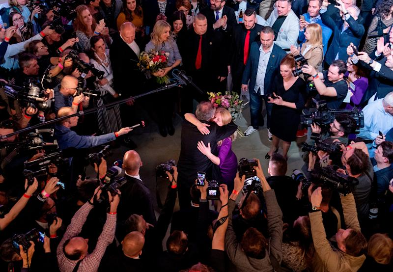 Slovak President Andrej Kiska congratulates Slovakia's President-elect Zuzana Caputova as she wins the election in Bratislava, Slovakia on March 30, 2019. | Joe Klamara—AFP/Getty Images