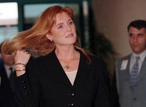 "FILE - In this Wednesday, June 10, 1998 file photo Britain's Duchess of York, Sarah Ferguson arrives at Istanbul's Ataturk airport. A Turkish court has begun a trial Friday May 4, 2012 against Britain's Duchess of York for allegedly taking part in the secret filming of two orphanages in Turkey, the state-run news agency said. Sarah Ferguson, who is being tried in absentia, faces charges of going ""against the law in acquiring footage and violating privacy"" of five children at one of the orphanages, the Anadolu Agency said. If convicted, she could receive a maximum sentence of 22 1/2 years in prison. (AP Photo/Murad Sezer, File)"