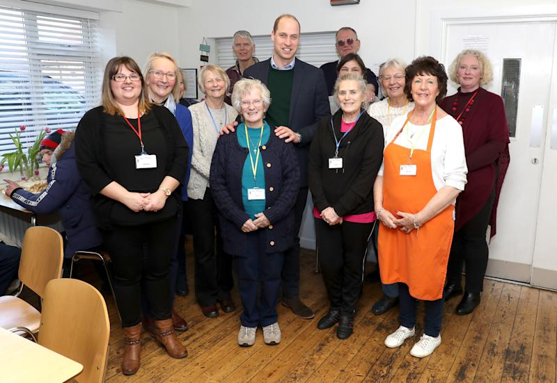 The Duke of Cambridge poses with volunteers during a visit to the Beacon Project, a day centre which gives support to the homeless, excluded and marginalized in Mansfield, Nottinghamshire.