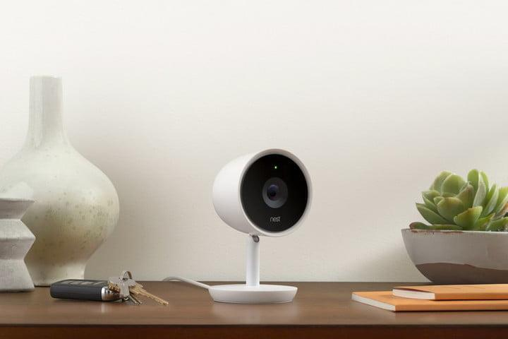 Nest Cam IQ sitting on a desk next to car keys and books