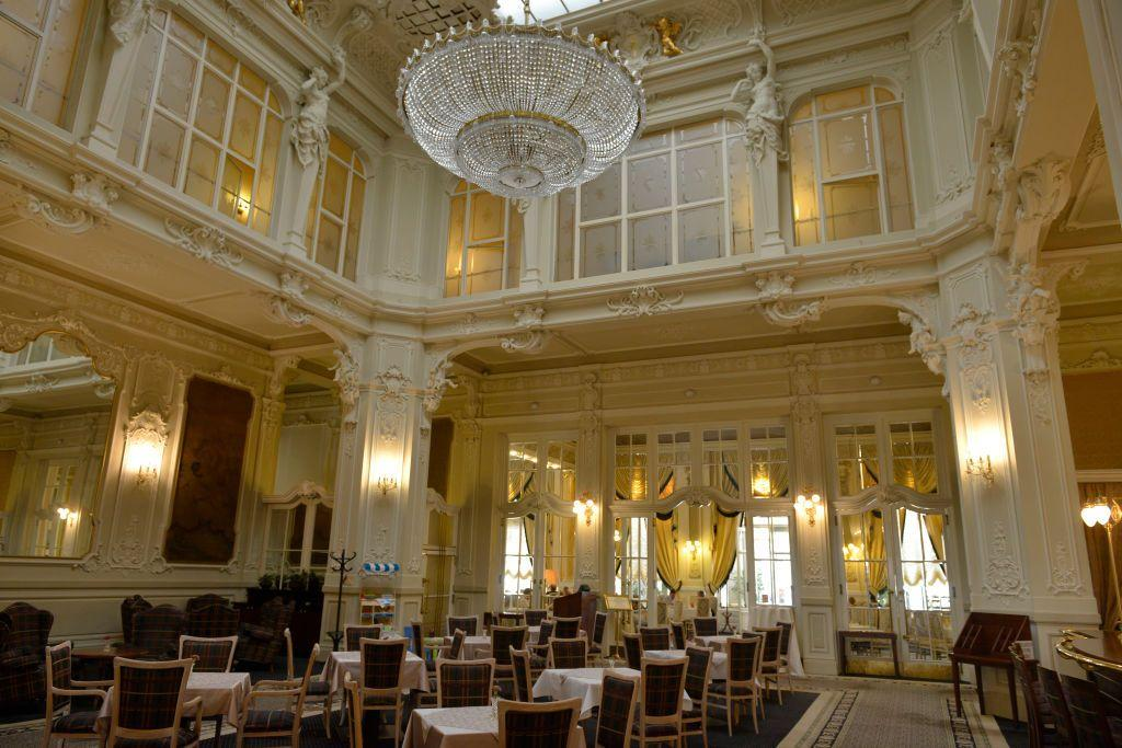 <p>The Grand Budapest Hotel's interior was a built set, but the references were mostly pulled from The GrandHotel Pupp in Karlovy Vary.  The town, once known as Karlsbad, has entertained visitors for over a century at the historic hotel, which is famous for it's intricate plasterwork and red carpets.</p>