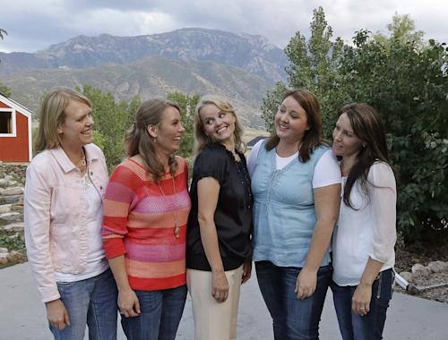 "In this Sept. 11, 2013, photo, Brady Williams five wife's, from left to right, Robyn, Nonie, Rhonda, Rosemary and Paulie, pose for a photograph outside of their home in a polygamous community outside Salt Lake City. Brady Williams has five wives, 24 children but no organized religion. The latest polygamous family from Utah to open its lives to America via reality TV is a tried and true plural family.The family says their plural lifestyle is rooted in love and commitment rather than religion. The kids range from age 2 to 20, and five are named Brady. A one-hour special called ""My Five Wives"" is set to air Sunday on TLC offering a glimpse into the family's life. (AP Photo/Rick Bowmer)"