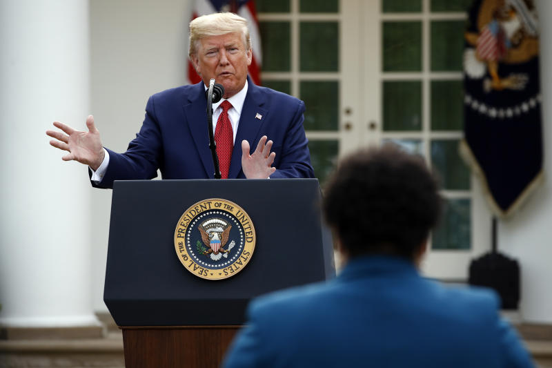 President Donald Trump answers a question from PBS reporter Yamiche Alcindor during a coronavirus task force briefing in the Rose Garden of the White House, Sunday, March 29, 2020, in Washington. (AP Photo/Patrick Semansky)