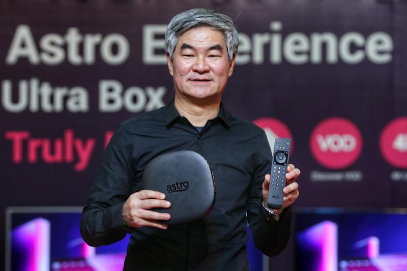 Astro Group's chief executive officer Henry Tan showing off the new Ultra Box and its accompanying remote control. — Picture by Ahmad Zamzahuri