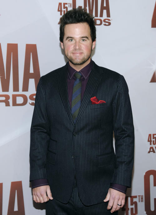 "FILE - In this Nov. 9, 2011 file photo, David Nail arrives at the 45th Annual CMA Awards in Nashville. Going into the recording studio for his third album, country singer-songwriter David Nail was ready to move beyond his reputation for emotionally heavy, slow ballads that painted him professionally into a box. So when he heard the song that would eventually become the first single from ""I'm A Fire,"" he realized it was a turnaround for both his career and his attitude.(AP Photo/Evan Agostini)"