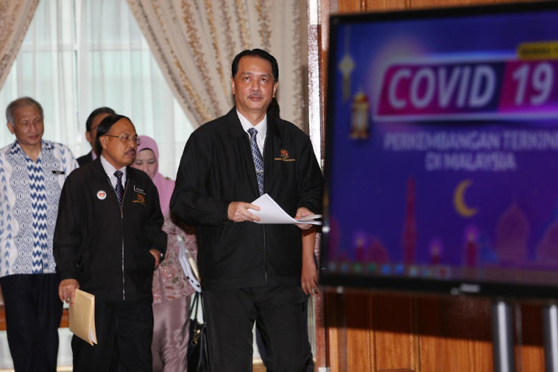 Arrival of Health director-general Datuk Dr Noor Hisham Abdullah for the press conference on Covid-19 in MOH , Putrajaya, May 28, 2020. — Picture by Choo Choy May