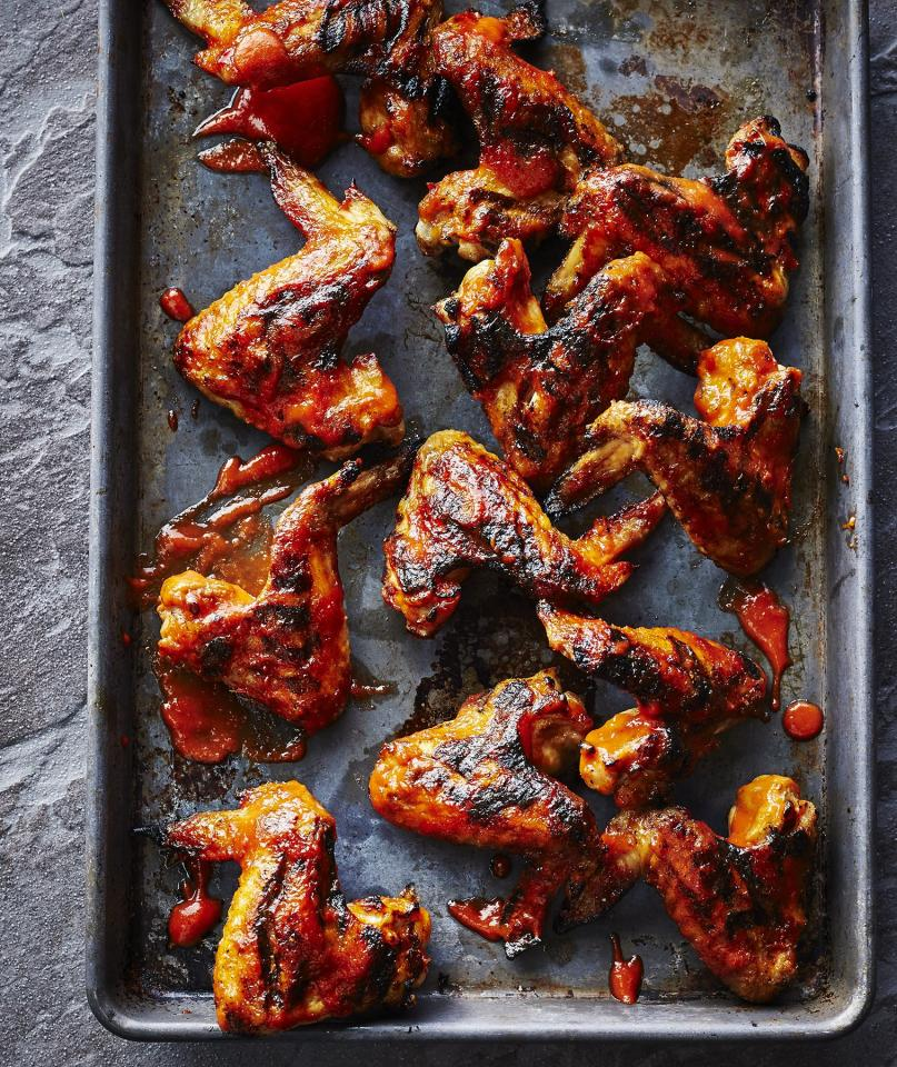 "<p>These chicken wings are so good, you'll keep them on rotation before, during, and after football season. The sweet and sour Bourbon sauce helps the wings get nice and crispy on the grill, and they pair well with traditional cookout fixings such as slaw and potato salad.</p> <p> <strong>Get the recipe: </strong><a href=""https://www.realsimple.com/food-recipes/browse-all-recipes/cherry-bourbon-chicken-wings"" target=""_blank"">Cherry Bourbon Chicken Wings</a></p>"
