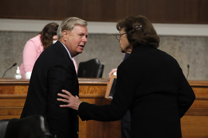 Chairman Lindsey Graham, R-S.C., talks with Sen. Dianne Feinstein, D-Calif., after a Senate Judiciary Committee business meeting to consider authorization for subpoenas relating to the Crossfire Hurricane investigation, and other matters on Capitol Hill in Washington, Thursday, June 11, 2020. (AP Photo/Carolyn Kaster, Pool)