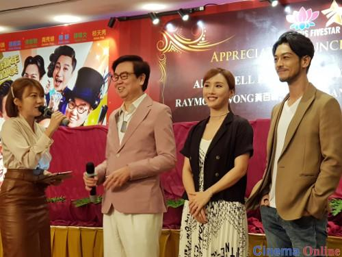 "Producer Raymond Wong with ""All's Well, Ends Well 2020"" cast members Dada Chan and Adam Pak greeting the crowd."