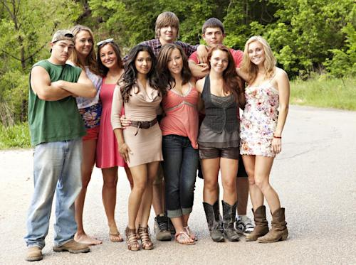 "FILE - This undated image originally released by MTV shows the cast of the new reality series ""Buckwild,"" from left, Shain Gandee, Anna, Katie, Salwa, Joey, background center, Ashley, Tyler, background right, Cara and Shae. MTV said Wednesday, April 10, 2013, it is canceling its West Virginia-based reality TV show ""Buckwild"" a week after the accidental death of 21-year-old star Shain Gandee. Network spokesman Jake Urbanski confirmed the news, saying it was ""not an easy decision."" (AP Photo/MTV, file)"