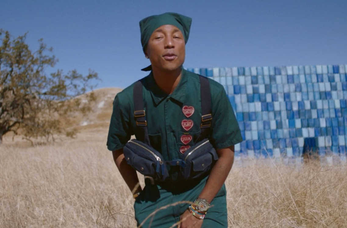 <p>During the sequence for 'Water' with Salatiel, Williams appears in front of a large blue tile wall, wearing a teal outfit.</p>