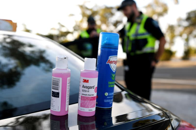 Disinfectant products are seen on a car whilst motorists fill out paperwork for police as they cross back into South Australia from Victoria during the coronavirus disease (COVID-19) outbreak, in Bordertown