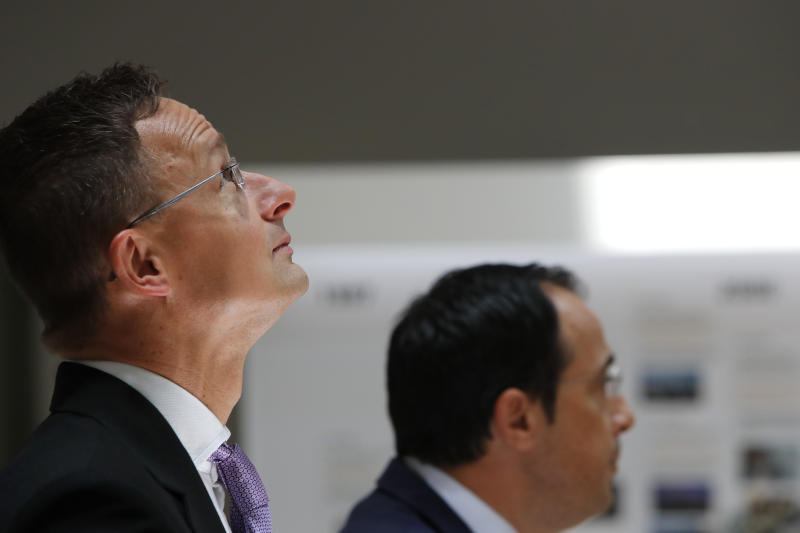 Hungarian Minister of Foreign Affairs and Trade Peter Szijjarto, left, and Cyprus' Foreign Minister Nikos Christodoulides speak during a news conference at the Cypriot foreign ministry on Friday, June 26, 2020. Szijjarto is in Cyprus for one-day visit. (AP Photo/Petros Karadjias)