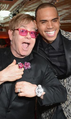 Chris Brown makes some new friends at Elton John's Oscar soiree