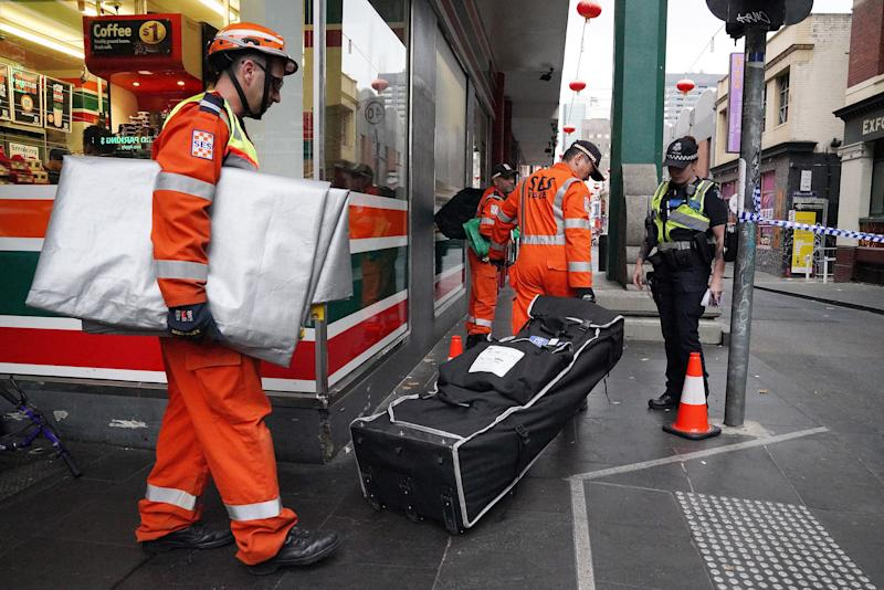 SES workers enter the scene on Little Bourke St. Source: AAP