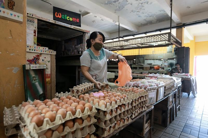 Hor is pictured selling fresh eggs at the Old Town Wet Market in Petaling Jaya March 25,2020. — Picture by Ahmad Zamzahuri