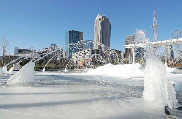 PHOTO: Water squirts from a frozen fountain near downtown in Charlotte, N.C., on Jan. 2, 2018. (Chuck Burton/AP)