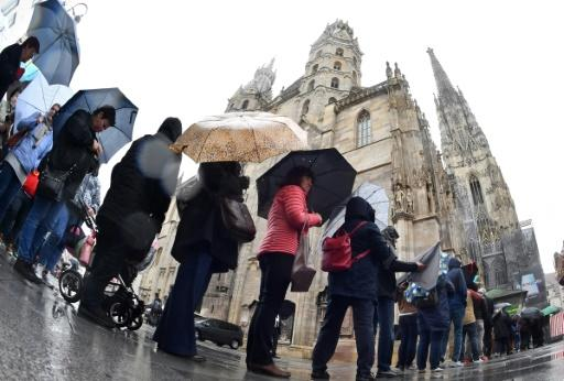 Thousands of mourners gathered in pouring rain outside the cathedral