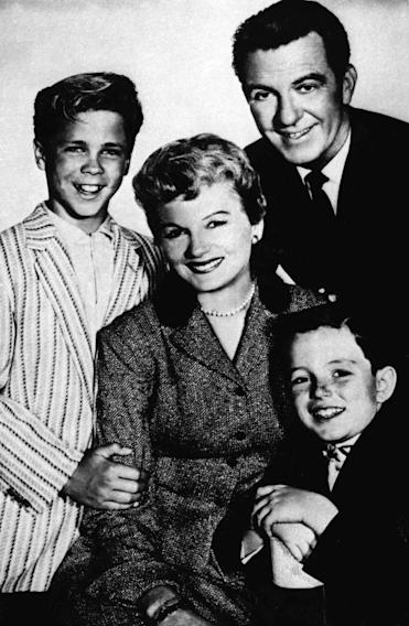 "FILE - In this undated file photo, from left, Tony Dow as Wally, Barbara Billingsley as June, Hugh Beaumont as Ward and Jerry Mathers as Beaver, the cast of the TV series ""Leave It to Beaver"", pose for a publicity portrait. Billingsley, who gained the title supermom for her gentle portrayal of June Cleaver, the warm, supportive mother of a pair of precocious boys in ""Leave it to Beaver,"" has died Saturday, Oct. 16, 2010. She was 94. (AP Photo/File)"