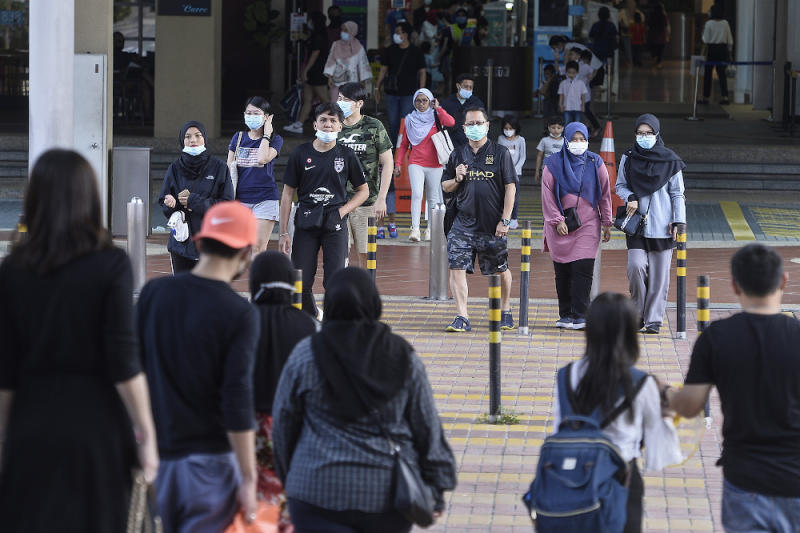 People wearing face masks in Kuala Lumpur July 11, 2020. A survey found that in the face of unprecedented health and economic disruption caused by the Covid-19 pandemic, millennials and Generation-Zs (Gen-Zs) have expressed their resolve to build a better future. — Picture by Miera Zulyana