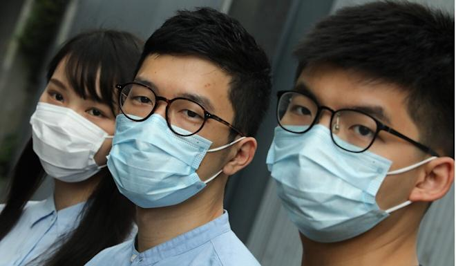 Demosisto activists Agnes Chow Ting, Nathan Law Kwun-chung, and Joshua Wong speak out against the national security law for Hong Kong. Photo: K. Y. Cheng
