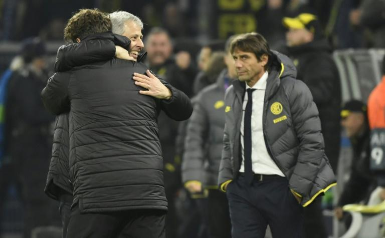 Dortmund's Swiss head coach Lucien Favre celebrates Tuesday's 3-2 victory while Inter Milan's coach Antonio Conte (R) looks on