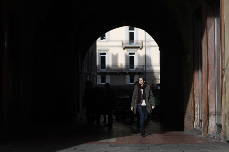 In this photo taken on Thursday, Jan. 30, 2020, Elly Schlein walks on a street after an interview with the Associated Press, in downtown Bologna, Italy. A dual U.S.-Italian citizen who cut her political organizing teeth on two Barack Obama campaigns is emerging as the latest rising star in Italian politics. (AP Photo/Antonio Calanni)