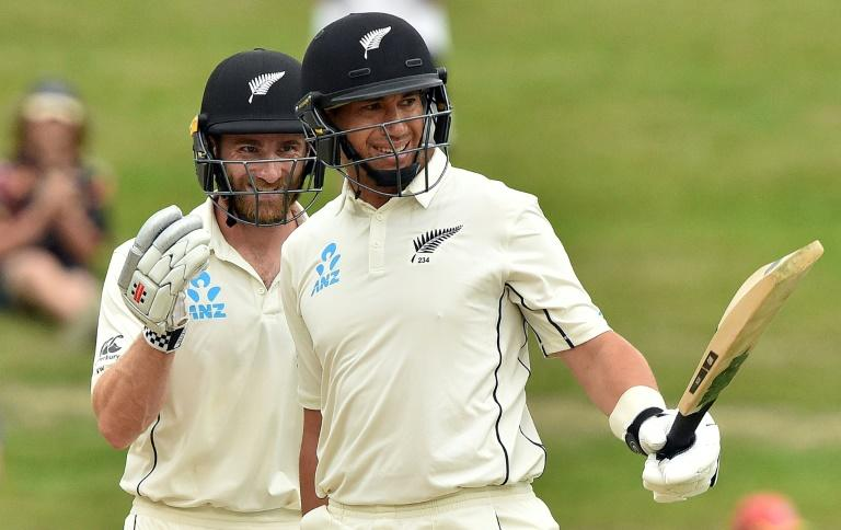 New Zealand's Ross Taylor (right) celebrates reaching his century with Kane Williamson