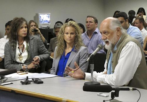 Aerosmith lead singer Steven Tyler, left, his attorney Dina LaPolt, center, listen as Fleetwood Mac drummer Mick Fleetwood testifies on celebrity privacy during a hearing at the Hawaii Capitol in Honolulu on Friday, Feb. 8, 2013. Rock legends Steven Tyler and Mick Fleetwood convinced a Hawaii Senate committee on Friday to approve a bill to protect celebrities or anyone else from intrusive paparazzi. The state Senate Judiciary Committee approved the so-called Steven Tyler Act after the stars testified. The bill would give people power to sue others who take photos or video of their private lives in an offensive way. (AP Photo/Oskar Garcia)