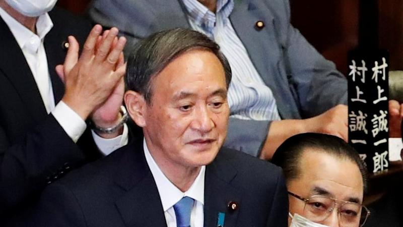 Japan's Yoshihide Suga elected prime minister, to announce 'continuity' cabinet