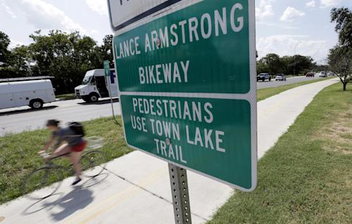 A cyclist rides along the Lance Armstrong Bikeway, Friday, Aug. 24, 2012, in Austin, Texas. The U.S. Anti-Doping Agency stripped Armstrong's seven Tour de France titles Friday, erasing one of the most incredible achievements in sports after deciding he had used performance-enhancing drugs to do it. (AP Photo/Eric Gay)