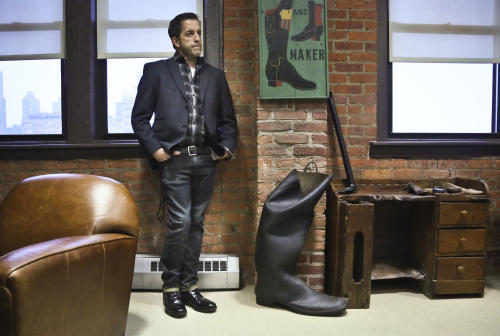 This Jan. 29, 2013 photo shows designer Kenneth Cole in his office during an interview in New York. Cole returns to New York Fashion Week Thursday, Feb. 6, after a seven-year hiatus, seemingly putting his hand on everything before the runway lights go up: the clothes, the shoes, the handbags, the hashtags. He bought his company back from investors last year, and it's once again privately owned with Cole fully in charge. (AP Photo/Bebeto Matthews)