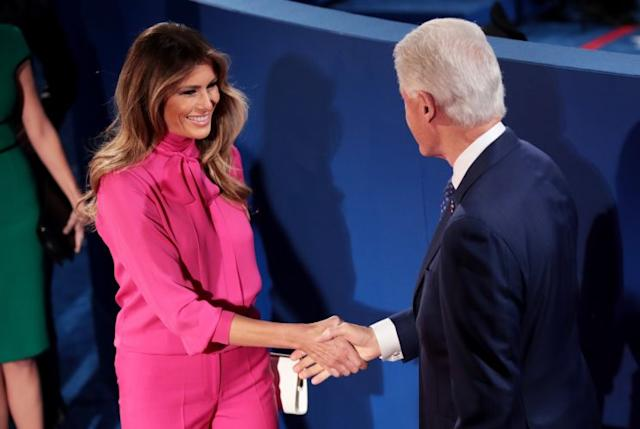 Melania Trump shakes hands with Bill Clinton at the second presidential debate on Sunday evening. (Photo: Getty Images)