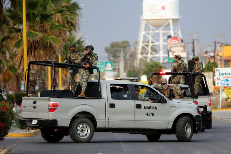 Mexico's Navy personnel patrol an area after a shooting with unknown assailants, in Cortazar