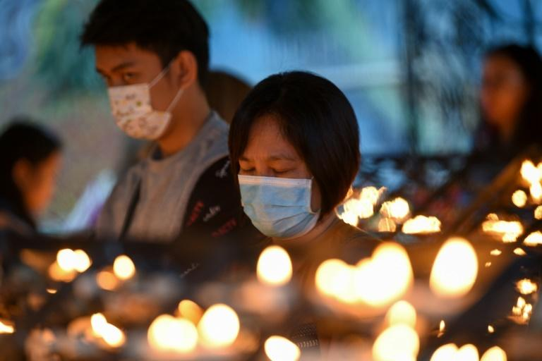 Many worshippers wore face masks to ward off the coronavirus during Ash Wednesday services in Manila