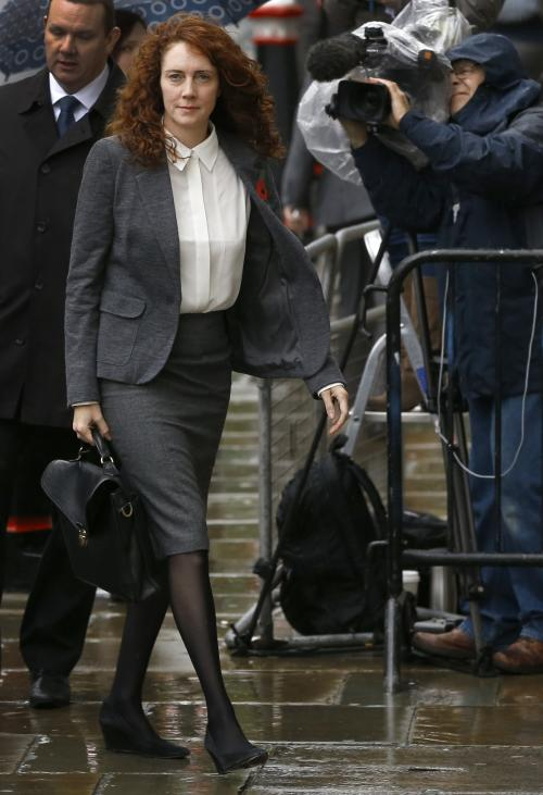 Rebekah Brooks arrives at The Old Bailey law court in London, Thursday, Oct. 31, 2013. Former News of the World national newspaper editors Rebekah Brooks and Andy Coulson went on trial Monday, along with several others, on charges relating to the hacking of phones and bribing officials while at the now closed tabloid paper. (AP Photo/Kirsty Wigglesworth)
