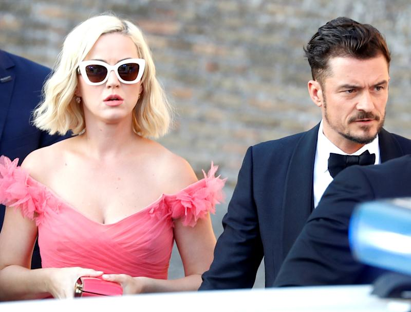 Singer Katy Perry and actor Orlando Bloom arrive to attend the wedding of fashion designer Misha Nonoo at Villa Aurelia in Rome, Italy, September 20, 2019. REUTERS/Yara Nardi