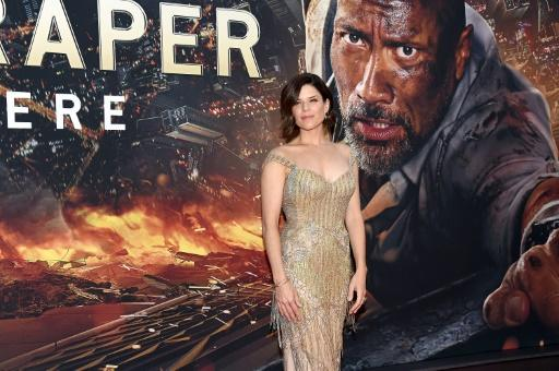 """""""Skyscraper"""" has been admired in some quarters for presenting women in empowering roles, including Neve Campbell, who plays Dwayne Johnson's hard-as-nails ex-military wife"""