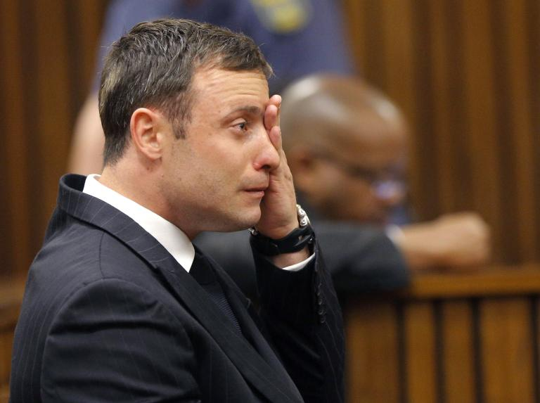 Olympic and Paralympic track star Pistorius reacts as he listens to Judge Masipa's judgement at the North Gauteng High Court in Pretoria
