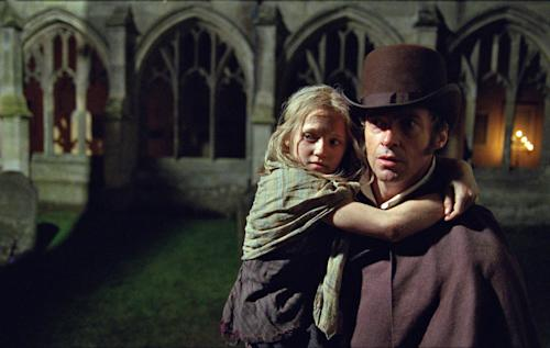 "FILE - This publicity film image released by Universal Pictures shows Hugh Jackman as Jean Valjean holding Isabelle Allen as Young Cosette in a scene from ""Les Miserables."" Best-picture prospects for Oscar Nominations on Thursday, Jan. 10, 2013, include, ""Lincoln,"" directed by Steven Spielberg; ""Zero Dark Thirty,"" directed by Kathryn Bigelow; ""Les Miserables,"" directed by Tom Hooper; ""Argo,"" directed by Ben Affleck; ""Django Unchained,"" directed by Quentin Tarantino; and ""Life of Pi,"" directed by Ang Lee. (AP Photo/Universal Pictures, Laurie Sparham, File)"