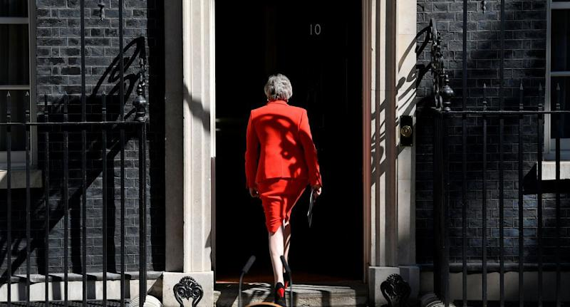 British Prime Minister Theresa May leaves after announcing her resignation.