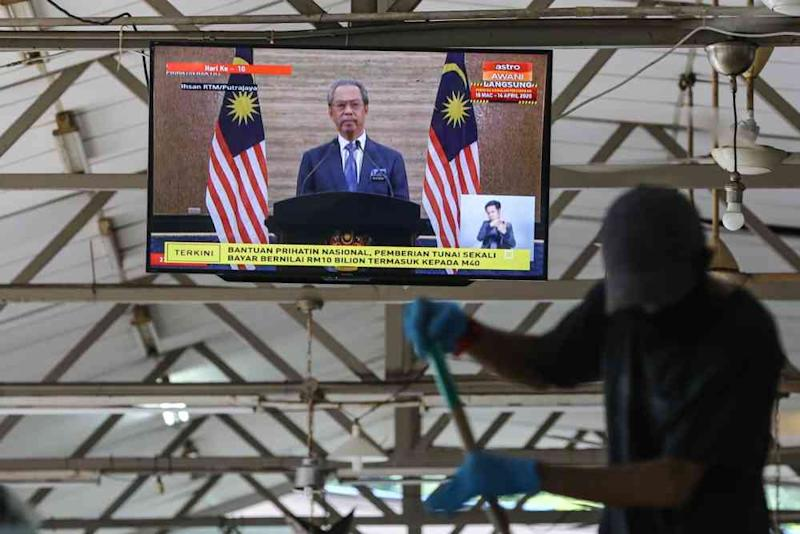 A live broadcast of Prime Minister Tan Sri Muhyiddin Yassin on the special Covid-19 stimulus package is seen on a television in Kuala Lumpur March 27, 2020. ― Picture by Yusof Mat Isa