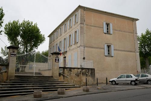 """Mazan town hall, Sunday, May 5, 2013, near Avignon, southern France. A French mayor says Oscar-nominated actress Keira Knightley has said """"oui"""" to rocker James Righton in a small wedding ceremony in southern France. Aime Navello said Sunday that the couple followed French tradition when he married them at the Mazan town hall Saturday. Navello read the service in French and the couple responded in French and English. He said about 10 people were present. Mont Ventoux, is seen in the background. (AP Photo/Claude Paris)"""