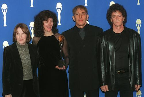FILE - In a Wednesday, Jan. 17, 1996 file photo, members of the band the Velvet Underground, from left, Maureen Tucker; Martha Morrison, attending for her late husband, Sterling Morrison; John Cale and Lou Reed pose backstage after their induction into the Rock and Roll Hall of Fame in New York s Waldorf-Astoria Hotel. Punk-poet, rock legend Lou Reed is dead of a liver-related ailment, his literary agen said Sunday, Oct. 27, 2013. He was 71. (AP Photo/Joe Tabacca, File)