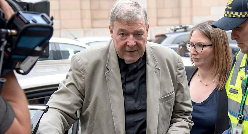 In this Feb. 26, 2019, photo, Cardinal George Pell arrives at the County Court in Melbourne, Australia.