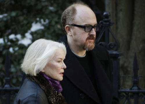 Ellen Burstyn and Louis C.K. arrive for the funeral of actor Philip Seymour Hoffman at the Church of St. Ignatius Loyola, Friday, Feb. 7, 2014 in New York. Hoffman, 46, was found dead Sunday of an apparent heroin overdose. (AP Photo/Mark Lennihan)