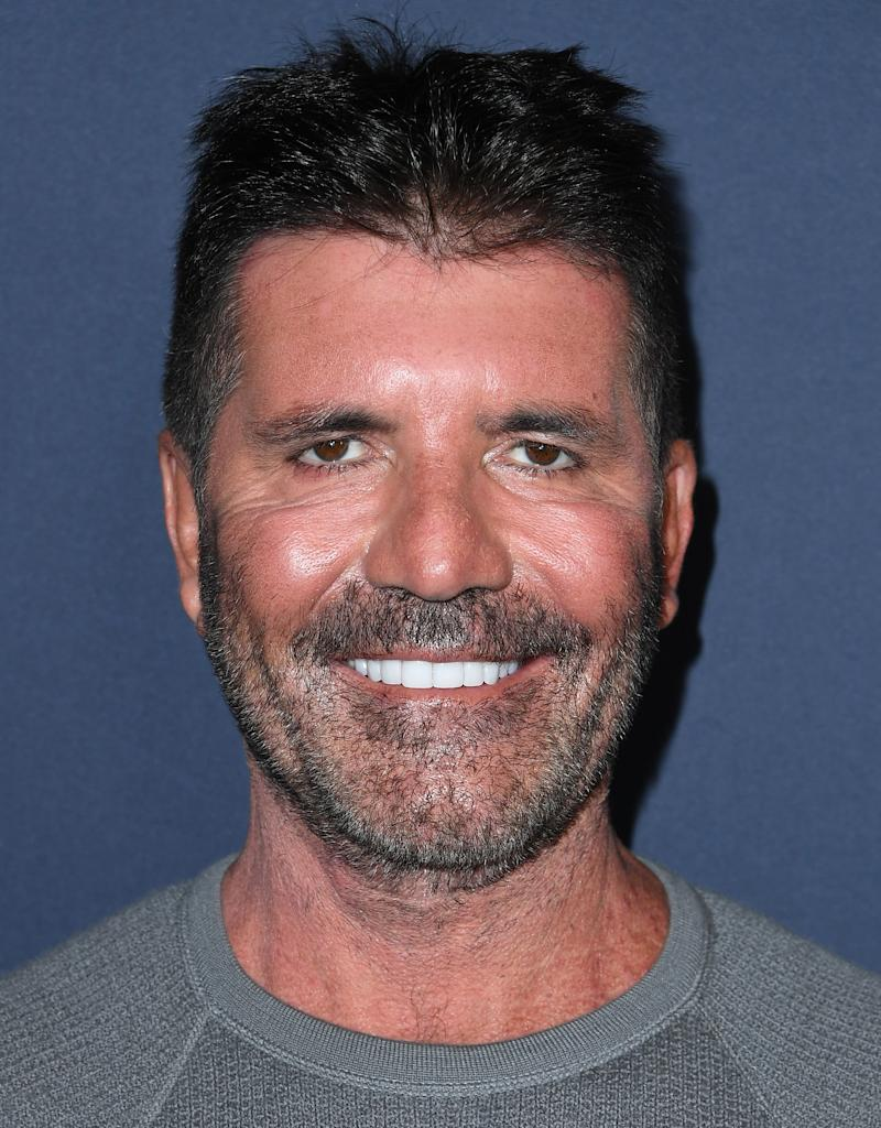 Simon Cowell flashed a blinding smile at the Britain's Got Talent 2019 Live Show. Photo: Getty Images