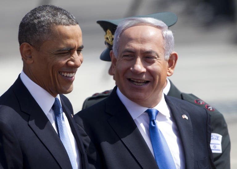 US President Barack Obama, left, and Israel's prime minister Benjamin Netayahu laugh during a welcoming ceremony upon Obama's arrival at Ben Gurion airport near Tel Aviv, Israel, Wednesday, March 20, 2013. President Barack Obama is declaring common cause with Israel, highlighting the bonds between the United States and its Mideast ally. He says he has made Israel the first stop of the first trip of his second term to restate his commitment to Israel's security. (AP Photo/Ariel Schalit)
