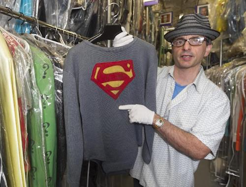 "In this Friday, Nov. 30, 2012 photo, James Comisar holds the costume George Reeves wore in the 1950s TV show ""Adventures of Superman."" The item is part of his television memorabilia collection in a temperature- and humidity-controlled warehouse in Los Angeles. (AP Photo/Damian Dovarganes)"